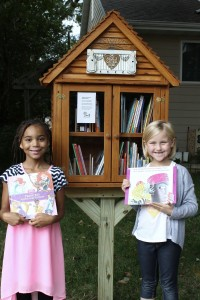 Two of Wayne and Sherry Petrik's grandchildren - Anayah Turner and Caelee LeBrun - are pictured utilizing the new Little Free Library.
