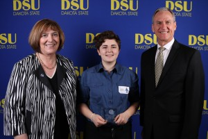 NCWIT local honorable mention winner Bergen Weiland is congratulated by Dakota State University President José-Marie Griffiths (left) and South Dakota Governor Dennis Daugaard at a ceremony at DSU on April 12.