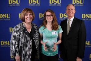 NCWIT local winner Janae Hahn is congratulated by Dakota State University President José-Marie Griffiths (left) and South Dakota Governor Dennis Daugaard at a ceremony at DSU on April 12.