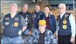 This Feb. 2, 2019 photo provided by Dakota State University.  Members of the United States Submarine Veterans Scorpion Base, including Mike Neuroth (seated), attended the USS-SD Commissioning watch party at Dakota State University on Feb. 2. Also pictured is the group's Vice Commander Brian Schnerr (left), Kent Winter, Larry Little, Gerald Davey, and Jim Farquhar.