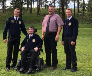 Ridge Hughbanks, Central Region National Vice President, Mason Machmiller, Dells FFA Chapter Vice President, Mr. Wolff, Dells FFA Chapter Advisor, Nathan Linke, South Dakota State FFA Treasurer. Photo taken by Alan Machmiller